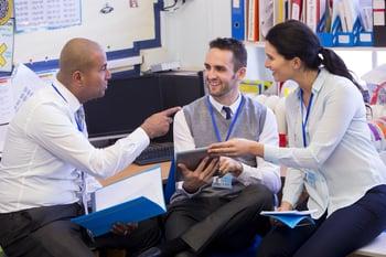 Three teachers discussing technology
