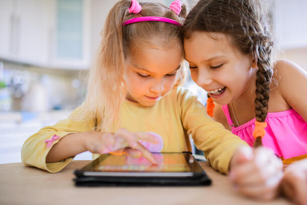 two young girls on ipad